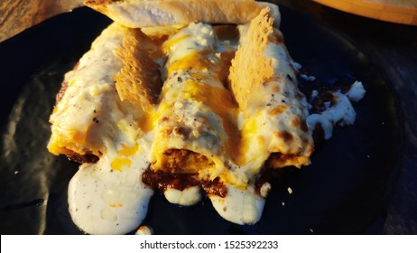Chicken Roll With Egg and White Sauce Topping...and filling of tandoori chicken cooked in cumin sauce.