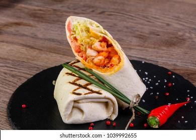 Chicken roll with tortilla served pepper