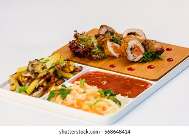 Chicken rolls with vegetables on a white background