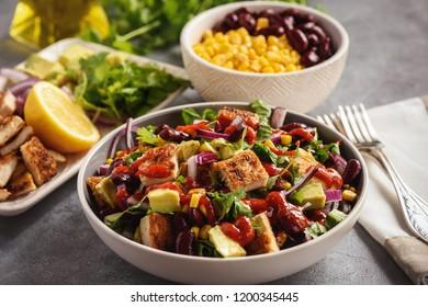 Chicken chicken salad with avocado, corn and bean.
