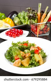 Chicken salad and fresh vegetable on table.