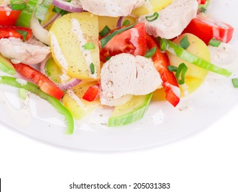 Chicken salad with potatoes and zucchini. Whole background.