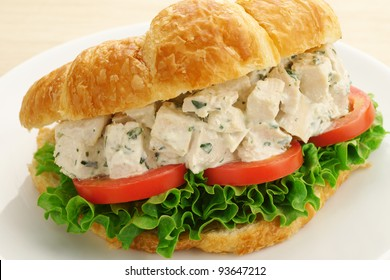Chicken Salad Sandwich with Lettuce and Tomato on a Croissant