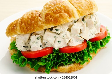 Chicken Salad Sandwich with Tomatoes and Lettuce on a Croissant