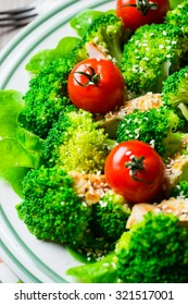 Chicken salad with tomatoes cherry, broccoli and white sesame