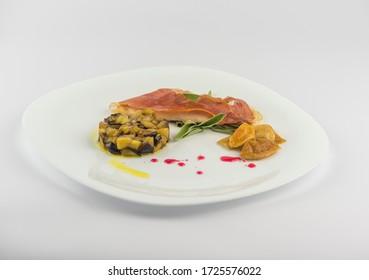 chicken saltibocca in white wine, with aubergines porcini mushrooms
