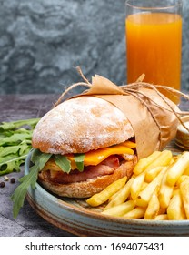 chicken sandwich with cheddar and rocket  served with french fries  orange juice  vertical