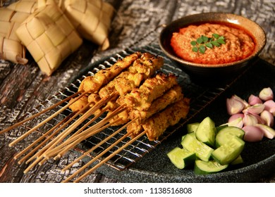Chicken Satay. Malay-styled char-grilled chicken meat on bamboo skewer; served with sweet peanut sauce, cucumber, shallots, and rice cake.