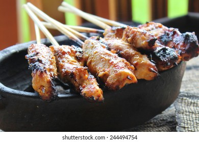 Chicken Satay over Coconut Charcoal