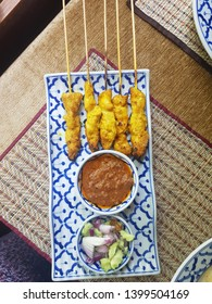 Chicken satay or Sate ayam is a Southeast Asian dish of seasoned, skewered and grilled chicken, served with a peanut sauce.
