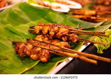 Chicken Satay Served On Banana Leaves At Street Market