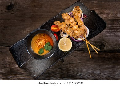 Chicken Satey on wooden table top view, Thai local food,Still Life Photo.