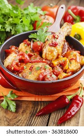 Chicken in a sauce of tomato and pepper on the table