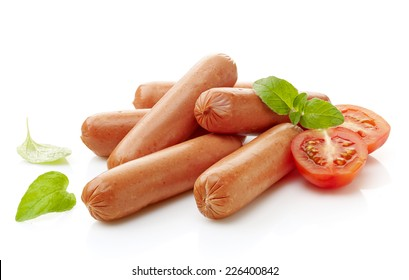 chicken sausages and tomato isolated on a white background