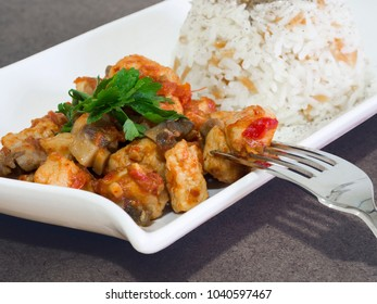 chicken sauteed in white plate and rice pilaf