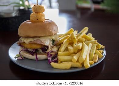 Chicken schnitzel burger and chips