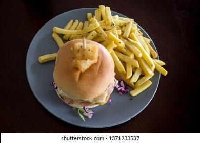 Chicken schnitzel burger and chips on the dish