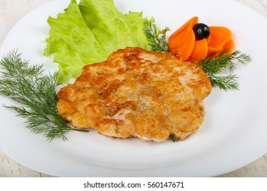 Chicken schnitzel served salad leaves and dill