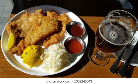 Chicken schnitzels served with lemon, mashed sweet pumkin, cabbage, and homemade dark beer