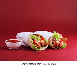 Chicken shawarma with tomato ketchup.