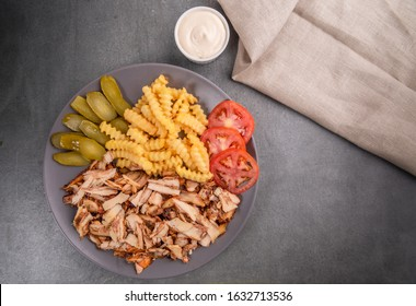 Chicken Shawerma meal, served with fries, pickles, tomatoes and tahini sauce