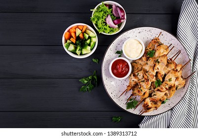 Chicken shish kebab. Shashlik - grilled meat and fresh vegetables. Top view