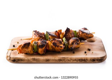 Chicken shish kebab with vegetables isolated on white background.