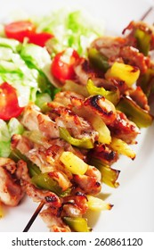 Chicken skewer with pineapple ready-to-eat, close up of one portion
