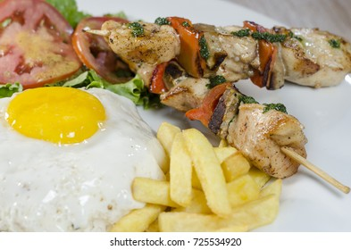 chicken skewers with egg and potatoes, peruvian food