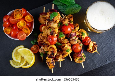 Chicken skewers marinated in turmeric yogurt served with lemon and mint