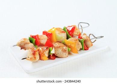 Chicken skewers on a cutting board