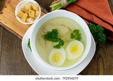 chicken soup with egg garnished with crunches