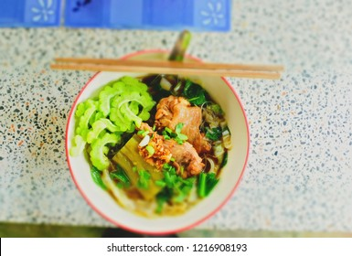 Chicken soup with noodles and vegetables; balsam apple, balsam pear, bitter cucumber, bitter gourd, bitter melon for delicious taste and good for health but can be found on street market