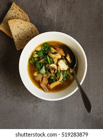 Chicken Soup with Spinach and Mushrooms.