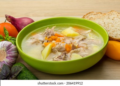 Chicken soup with vegetables and basil