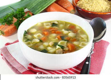 Chicken soup with vegetables and parsley in a bowl
