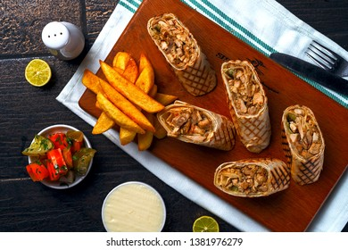 Chicken spring rolls or Chicken frankie with fries and sauce