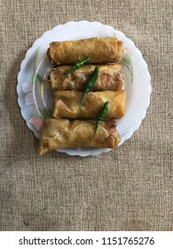 Chicken spring rolls top view, known as LUMPIA in Indonesia. Its famous hand made food from Semarang city, serve with hot green chilli or tomato sauce
