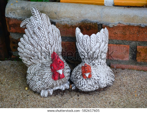 Chicken statues for decoration at the garden in Phuket, Thailand.