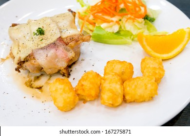 Chicken steak with bacon and hash brown