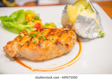chicken steak with baked potato