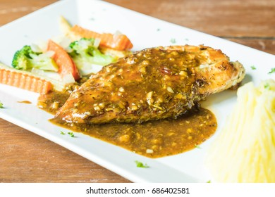 chicken steak with mashed potato and vagetable