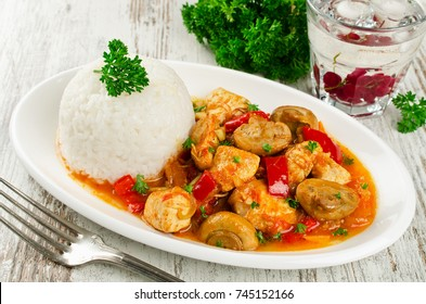 Chicken stew with mushrooms served  with rice. Healthy and low calorie food