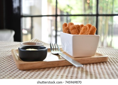 Chicken stick served with chessy and barbecue dip sauce