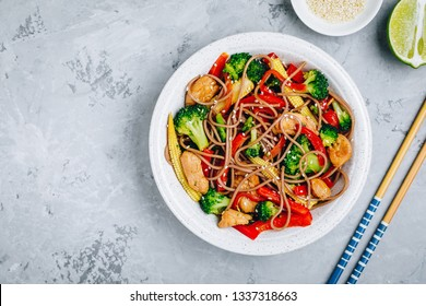 Chicken stir fry noodles bowl with broccoli. Top view