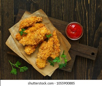 Chicken strips with ketchup. view from above.