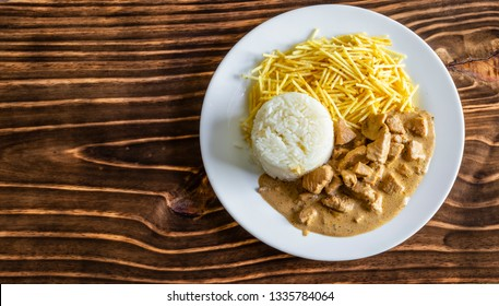 Chicken stroganoff meal on wood, space for text