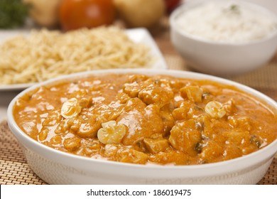Chicken strogonoff with fries and rice