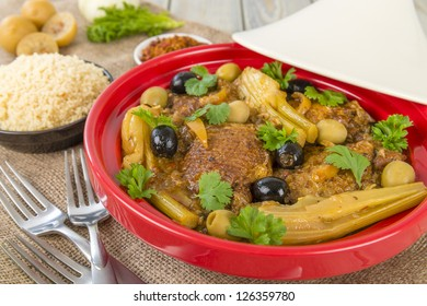 Chicken Tagine - Moroccan chicken tagine with olives, preserved lemon and fennel, served with couscous.