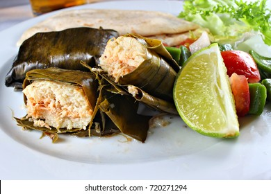 Chicken tamale served with vegetables, shallow focus